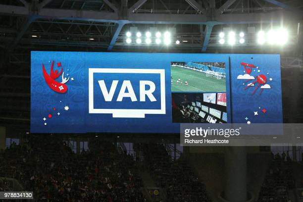 The big screen displays a VAR review to award a penalty to Egypt during the 2018 FIFA World Cup Russia group A match between Russia and Egypt at...