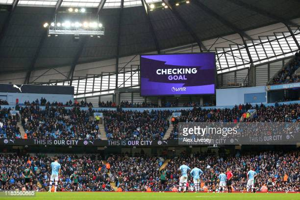 The big screen displays information during a VAR check for Manchester City's second goal during the Premier League match between Manchester City and...