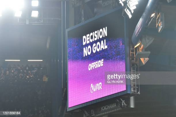 The big screen displays the decision after a VAR review disallowing a goal from Chelsea's French striker Olivier Giroud for offside during the...
