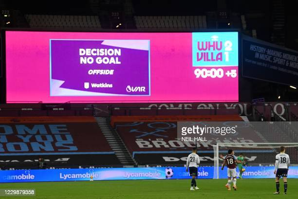 """The big screen displays the """"Decision No Goal"""" information after Aston Villa's English striker Ollie Watkins has his late equalizer disallowed for..."""