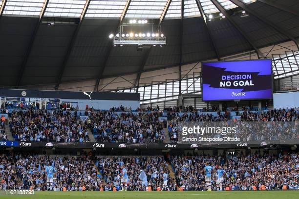 The big screen displays the 'No Goal' decision awarded by the Video Assistant Referee system late on during the Premier League match between...