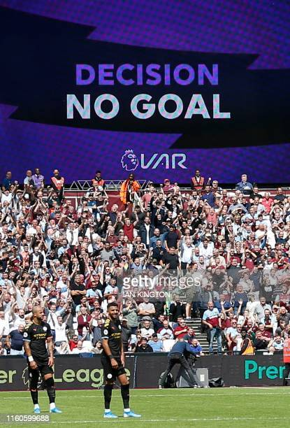 The big screen displays the no goal VAR decision to rule out what would have been Manchester City's third goal during the English Premier League...