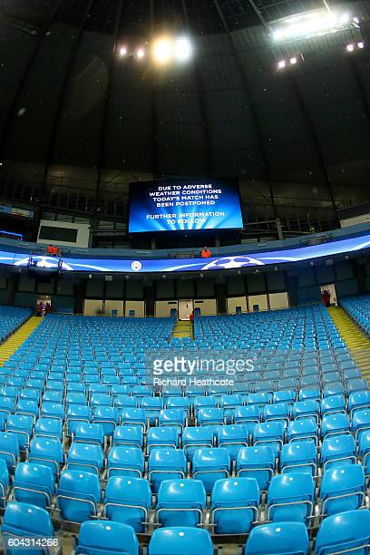 The big screen inside the stadium announces the postponement of the UEFA Champions League Group A match between Manchester City FC and VfL Borussia...