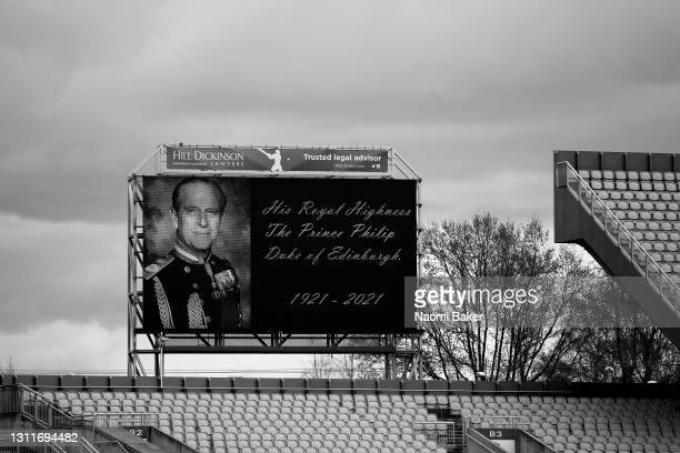 The big screen inside the stadium displays a message in relation to the death of Prince Philip, Duke of Edinburgh as players, staff and officials...