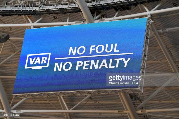 The big screen inside the stadium informs fans that referee Milorad Mazic has rescinded his decision to award Senegal a penalty after reviewing VAR...
