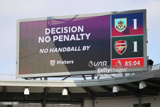 The big screen inside the stadium shows the VAR decision of no penalty, and no handball, after an incident with Erik Pieters of Burnley inside the...