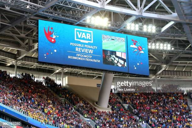 The big screen inside the stadium shows VAR in use for a penalty review during the 2018 FIFA World Cup Russia Round of 16 match between Sweden and...