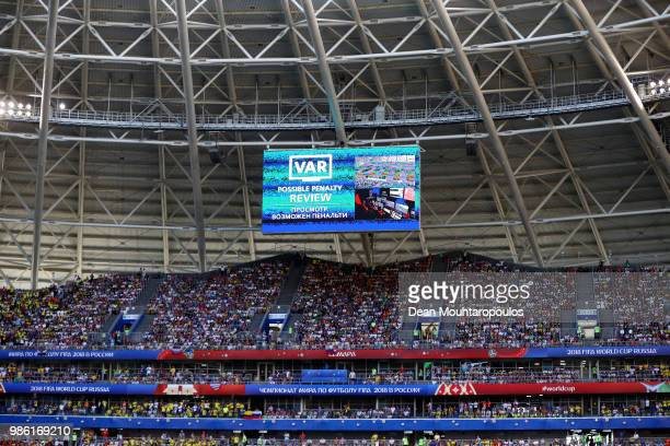 The big screen inside the staduim informs fans of a VAR review in consideration after referee Milorad Mazic awards Senegal a penalty which he then...