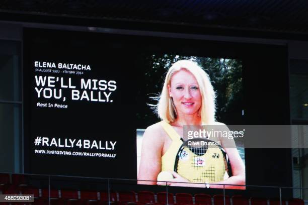 The big screen shows a photograph and message for former British tennis player Elena Baltacha who died of liver cancer aged 30 during day three of...