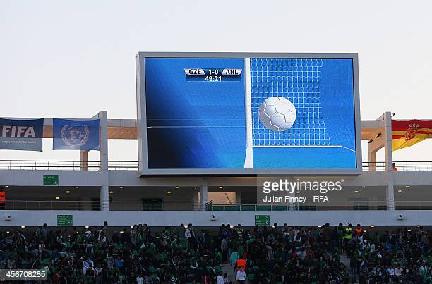 The big screen shows a replay of the ball crossing the line for a goal during the FIFA Club World Cup Quarter Final match between Guangzhou...