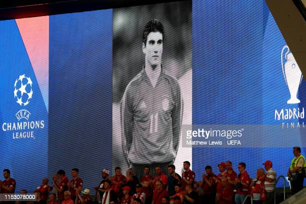 The big screen shows a tribute to Jose Antonio Reyes prior to the UEFA Champions League Final between Tottenham Hotspur and Liverpool at Estadio...