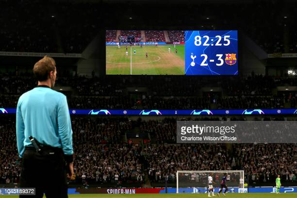 The big screen shows a worn out Wembley pitch during the Group B match of the UEFA Champions League between Tottenham Hotspur and FC Barcelona at...
