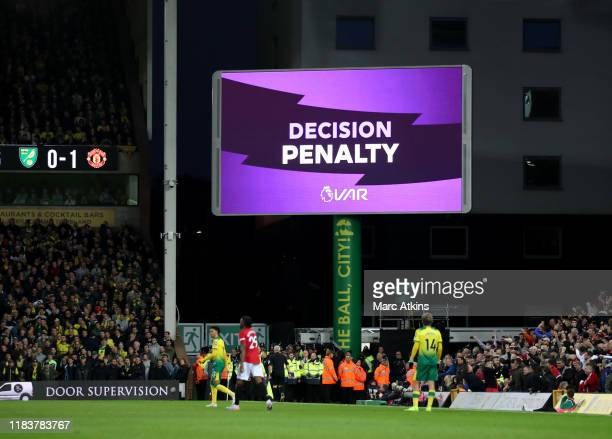 The big screen shows that a penalty has been awarded through to VAR during the Premier League match between Norwich City and Manchester United at...