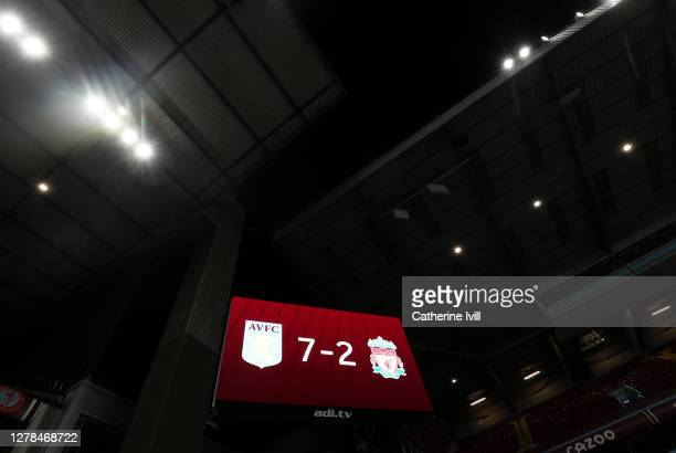 The big screen shows the final score of 7-2 after the Premier League match between Aston Villa and Liverpool at Villa Park on October 04, 2020 in...
