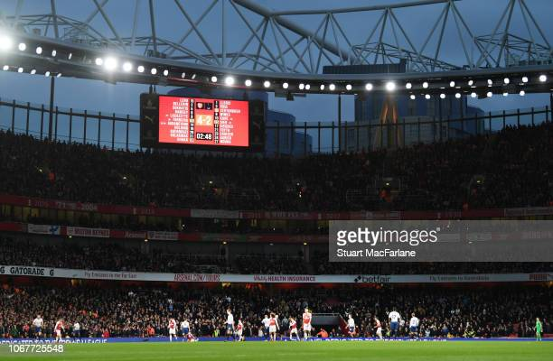 The big screen shows the score during the Premier League match between Arsenal FC and Tottenham Hotspur at Emirates Stadium on December 1 2018 in...