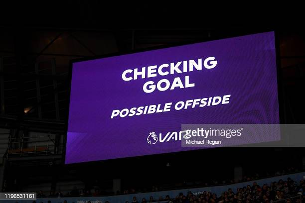 The Big screen shows the VAR check for a possible offside during the Premier League match between Manchester City and Sheffield United at Etihad...