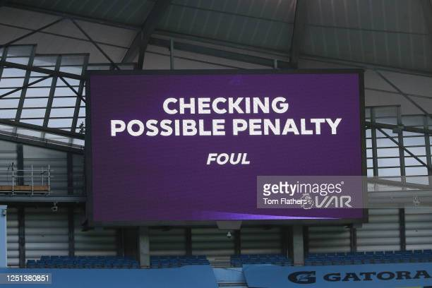 The big screen shows the VAR check for a possible penalty during the Premier League match between Manchester City and Burnley FC at Etihad Stadium on...