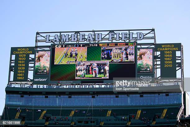 The big screen TV displays the thirteen years the Packers won the Super Bowl during an NFL football game between the Indianapolis Colts and the Green...