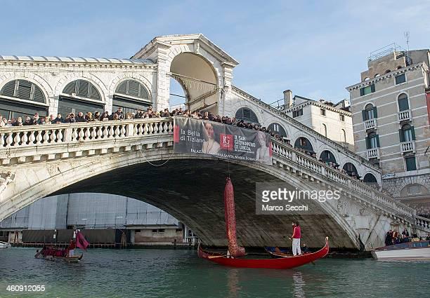 The big sock simbol of the Befana tradition is hanged on the Rialto Bridge ahead of the Befana Regatta on January 6 2014 in Venice Italy In Italian...