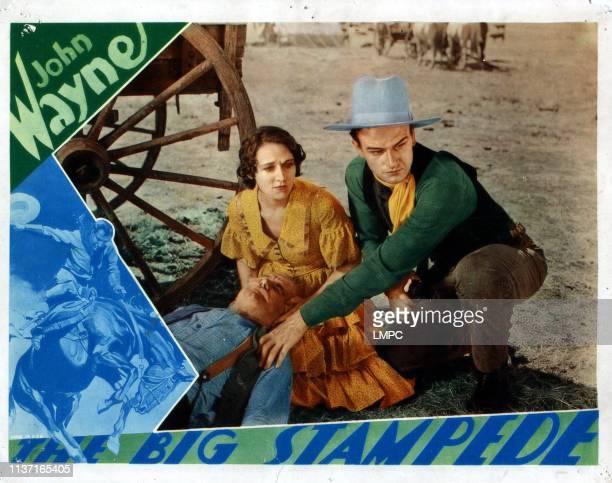 The Big Stampede lobbycard from left Mae Madison John Wayne 1932