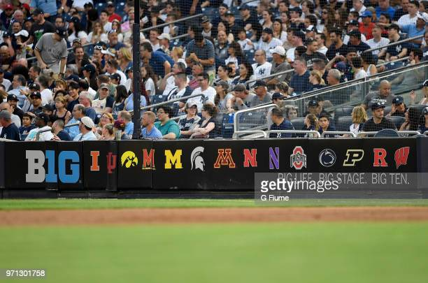 The Big Ten Conference and school logos on display at Yankee Stadium during the game between the New York Yankees and the Los Angeles Angels on May...