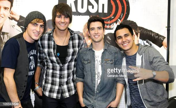 The Big Time Rush members Kendall Schmidt James Maslow Logan Henderson and Carlos Pena pose during a signing autographs sesion at the Best Buy store...