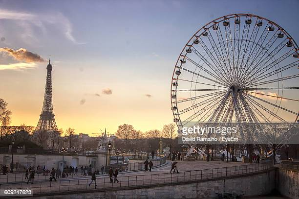 The Big Wheel And Eiffel Tower Against Sky During Sunset