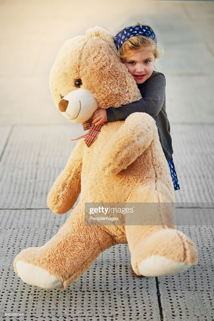 The bigger the bear, the bigger the cuddles : Stock Photo