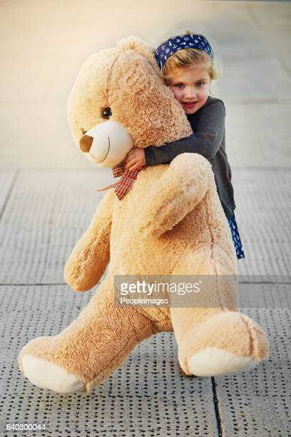 the bigger the bear, the bigger the cuddles - stor bildbanksfoton och bilder