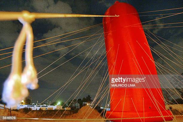 The biggest condom ever made can be seen 19 April 2004 in Sao Paulo Brazil The red condom made of nylon by Brazilian artist Degmar Covos as an...