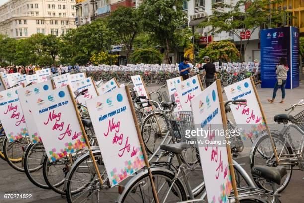The bikes are prepared to march by the girls dressed in traditional Vietnamese dress (ao dai)