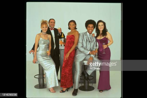 The Bill actors including George Rossi, Jane Wall, Karl Collins and Suzanne Maddock dressed in evening wear, circa 1999.