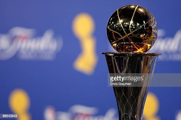 The Bill Russell MVP trophy is shown as Kobe Bryant of the Los Angeles Lakers speaks to the media after the Lakers defeated the Orlando Magic in Game...