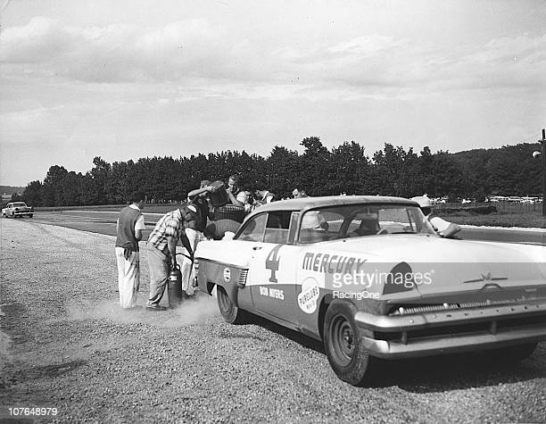 The Bill Stroppe pit crew services Bobby MyersÕ Mercury during a NASCAR Cup race at the 41mile Road America course Although Myers was involved in a...