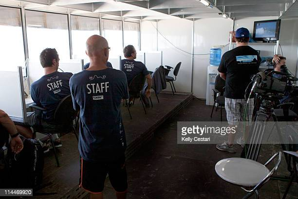 The Billabong Rio Pro judges watch the replay of a wave ridden to help make their decision on its score at Barra da Tijuca on May 20, 2011 in Rio de...