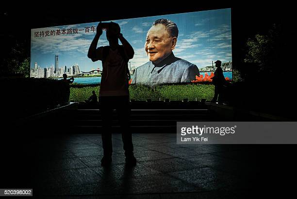 The billboard of Deng Xiaoping, the former Chinese leader who advocates One Country, Two Systems, stands at the Lo Wu border on April 3, 2016 in...