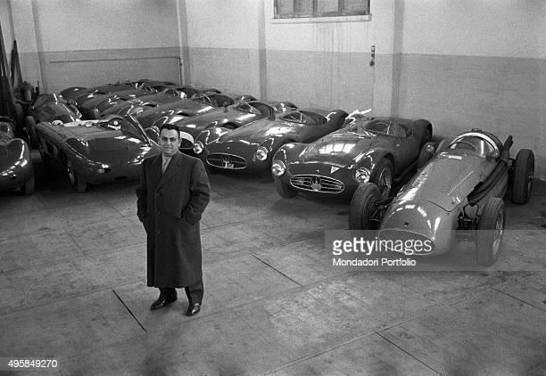 The billionaire entrepreneur Tony Parravano posing in the garage of Maserati race cars Modena 1950s