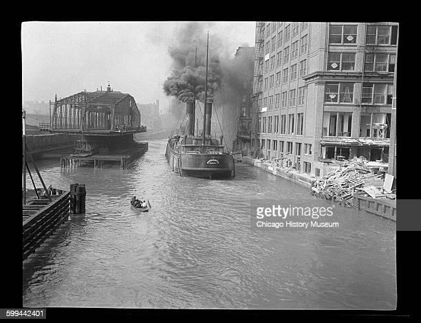 The Binghamton, a freight boat from Buffalo, New York, passing through the Adams Street Bridge, Chicago, Illinois, circa 1905.