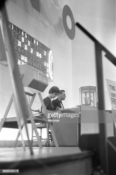 The bingo number caller sit on the stage of the Gaiety Theatre Cardif31st July 1963