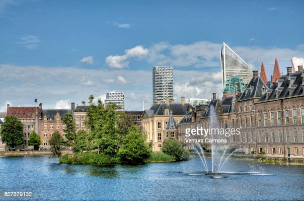 the binnenhof across the hofvijver - the hague - the netherlands - the hague stock photos and pictures