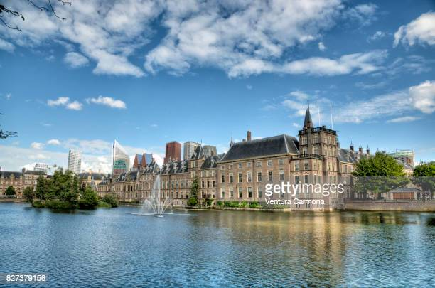 the binnenhof across the hofvijver - the hague - the netherlands - binnenhof stock photos and pictures
