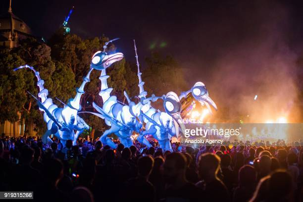 The birdman performers walks in front of The Serpent Mother art installation by the Flaming Lotus Girls during the White Night Melbourne festival...
