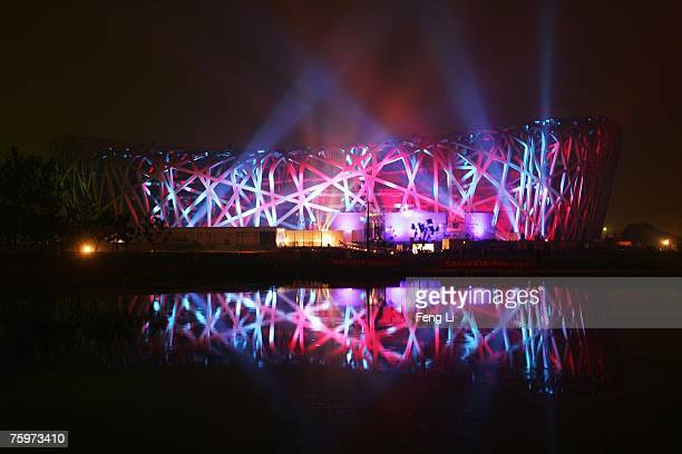 "The ""bird's nest"" National Stadium illuminated by colored lights is shown just over a year to the opening of the 2008 Olympic Games August 5,2007 in..."