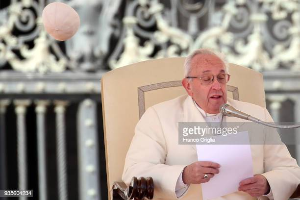 The biretta cup of Pope Francis is blown off his head by a gust of wind as he holds his weekly audience in St Peter's Square on March 21 2018 in...