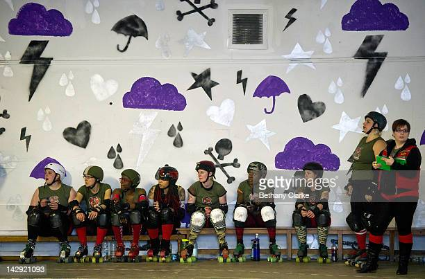 The Birmingham Blitz Dames sit on the side line before a Rollergirls Roller Derby event on April 14 2012 in Oldham England The contact sport of...