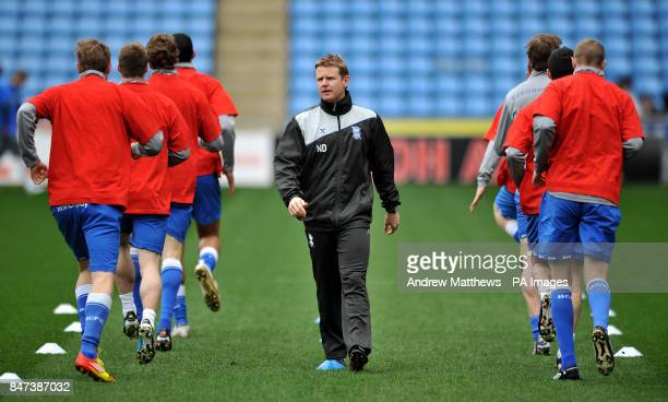 The Birmingham City players take part in the prematch warm up overlooked by Head of Sports Science Nick Davies