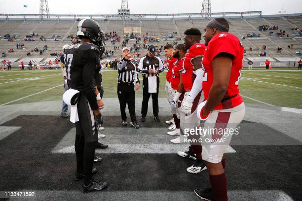 The Birmingham Iron and the San Antonio Commanders meet at midfield for the coin toss prior to an Alliance of American Football game at Legion Field...