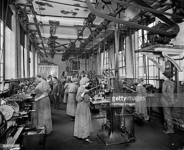 The Birmingham Small Arms factory Small Heath Birmingham February 1917 Men and women working on the machines in machine shop number five during the...