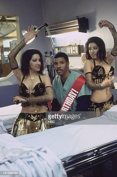 ER The Birthday Party Episode 17 Air Date Pictured Veena Bidasha as Belly Dancer Eriq La Salle as Doctor Peter Benton Neena Bidasha as Belly Dancer...