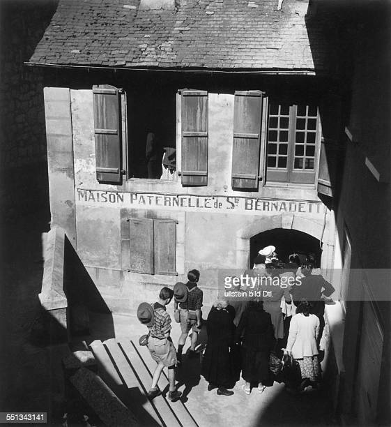 The birthplace of the saint Bernadette Soubirous with a lot of pilgrims at the entrance Vintage property of ullstein bild